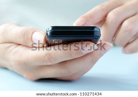 touchscreen phone in the hands of a young girl