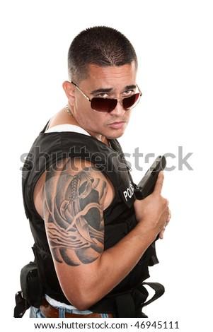 Tough Hispanic Cop in Bulletproof Vest Holding Pistol - stock photo