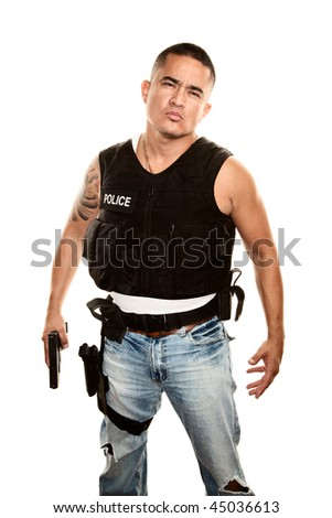 Tough Hispanic Cop with Pistol in Bulletproof Vest - stock photo