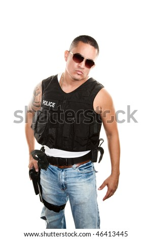 Tough Latino cop in jeans and a bulletproof vest - stock photo