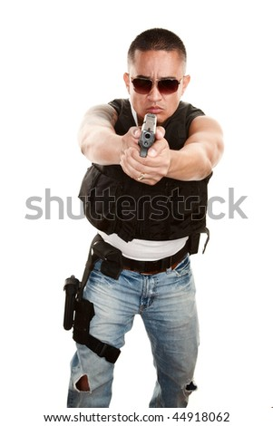 Tough Latino Cop Pointing Pistol at Camera - stock photo