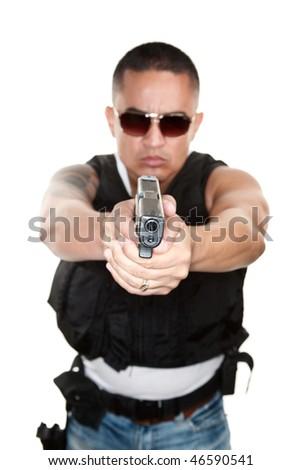 Tough Latino Cop Pointing Pistol at Camera - stock photo