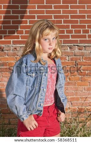Tough Little Girl Outdoors - stock photo
