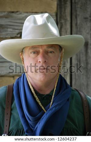 Tough looking cowboy - stock photo