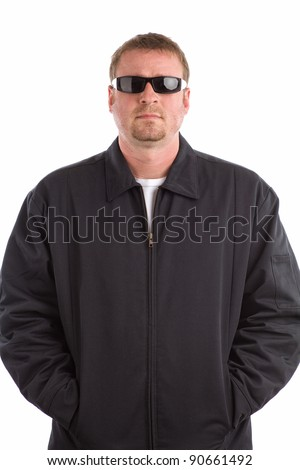 Tough Looking Guy with Hands in Pockets - stock photo