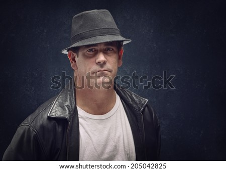 Tough looking man with serious expression, mobster or criminal
