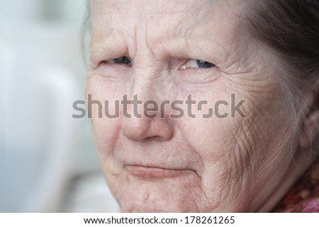 tough looking old woman, close up portrait