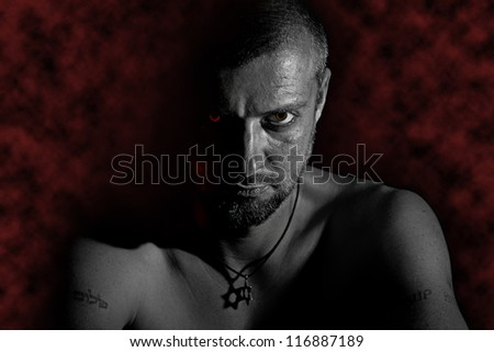 Tough man with star of David on his neck - stock photo