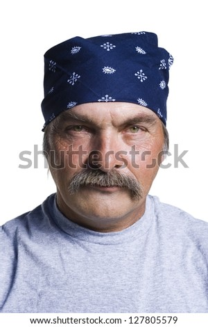 Tough middle aged man with head scarf - stock photo