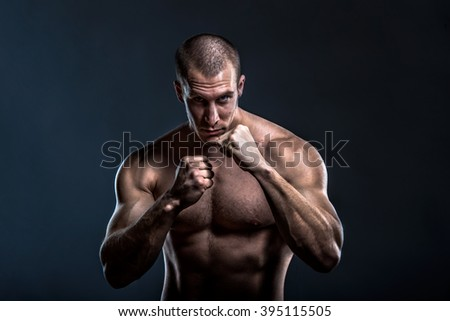 tough muscular male fighter - stock photo