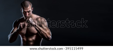 tough muscular male street fighter with copy space