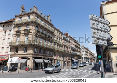 TOULOUSE, FRANCE - JULY 21, 2014: Rue de Metz runs through the heart of Toulouse. De street runs from Boulevard Lazare Carnot to Pont Neuf crossing the river Garonne. - stock photo