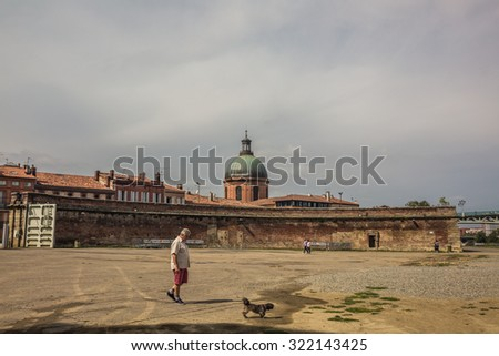 TOULOUSE, FRANCE - 13 SEPTEMBER, 2015; old Buildings in the city center of Toulouse and unidentified people - stock photo
