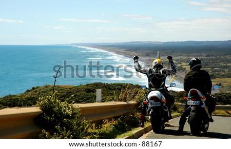 Tour bike pair reach their goal, West Coast, New Zealand Coastal Vista - stock photo
