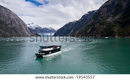 Tour boat returning from a glacier in Endicott Fijord - stock photo