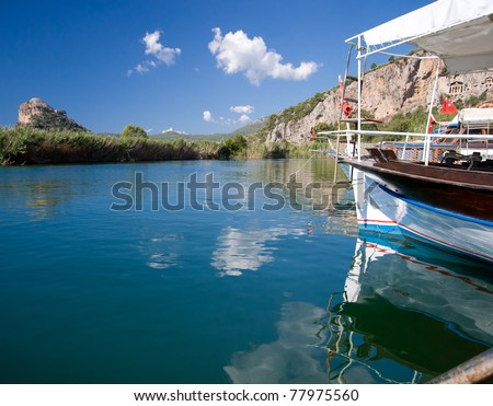 Tour boats ready for business on calm Dalyan River in Turkey