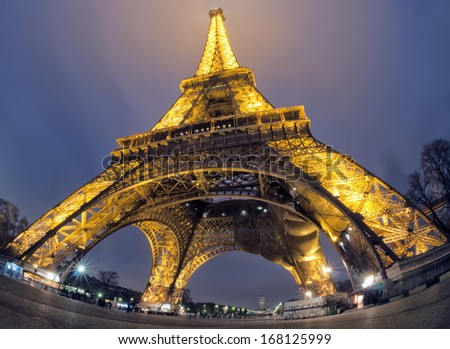Tour Eiffel at night with lights in the deep blue sky of Paris