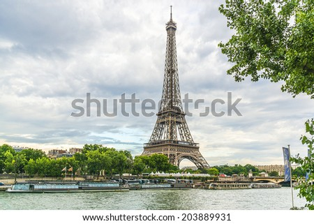Tour Eiffel (Eiffel Tower) at sunset. Eiffel Tower, named after engineer Gustave Eiffel, is tallest structure in Paris and most visited monument in the world. Champ de Mars, Paris, France. - stock photo