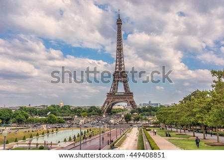 Tour Eiffel (Eiffel Tower) located on Champ de Mars in Paris, named after engineer Gustave Eiffel. Tower is tallest structure in Paris and most visited monument in world. France. View from Trocadero. - stock photo