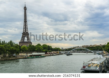 Tour Eiffel (Eiffel Tower), river Seine at sunset. Eiffel Tower, named after engineer Gustave Eiffel, is tallest structure in Paris and most visited monument in the world. Champ de Mars, Paris France. - stock photo
