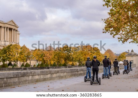 Tour groups of tourists on the streets of Paris in the autumn of Segway - stock photo