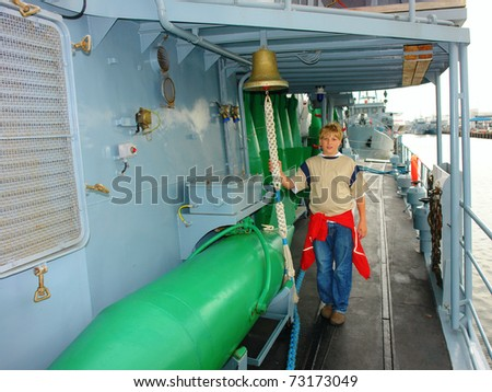 Tour on a military ship berthed on landing stage - stock photo