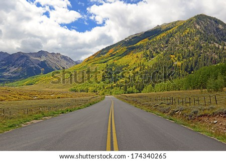 Touring America: Driving in the Rocky Mountains with Autumn Colors - stock photo