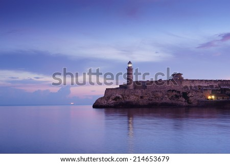 Tourism and travel destinations. Cuba, Caribbean sea, La Habana, Havana. View of morro and lighthouse from malecon. Copy space - stock photo