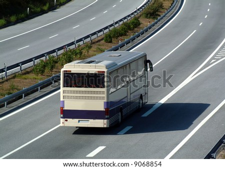 Tourism bus traveling fast on highway - stock photo