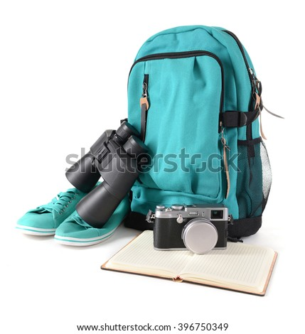 Tourism concept. Backpack, binocular and camera isolated on white background - stock photo