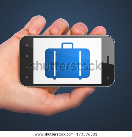 Tourism concept: hand holding smartphone with Bag on display. Mobile smart phone on Blue background, 3d render - stock photo