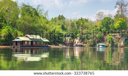 Tourism on the floating house rafting at the river Kwai, Kanchanaburi, Thailand.  - stock photo