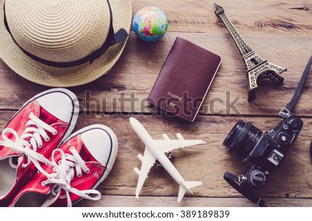Tourism planning and equipment needed for the trip on wooden floor - stock photo