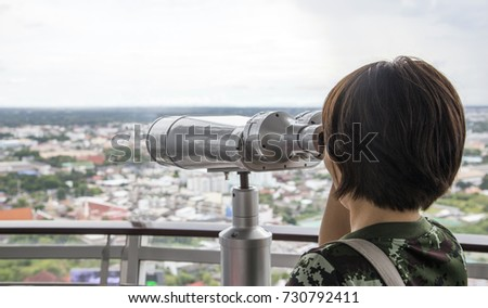 tourism watching sightseeing view with observation camera from high tower