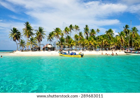Tourist arraving beautiful beach with crystal clear turquoise water. - stock photo