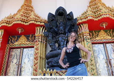 Tourist at a Thai temple - travel and tourism. - stock photo