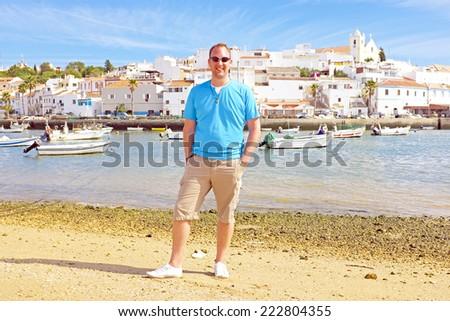 Tourist at the beach near Ferragudo Portugal - stock photo