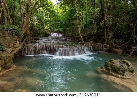 Tourist attraction; Huay Maekamin Waterfall in Kanchanaburi, Thailand.  - stock photo