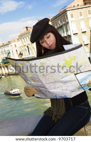 tourist attractions: this girl got lost in Venice - stock photo