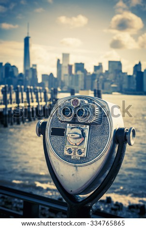Tourist binoculars at Liberty Island in front of Manhattan Skyline, vintage style, New York City, USA - stock photo