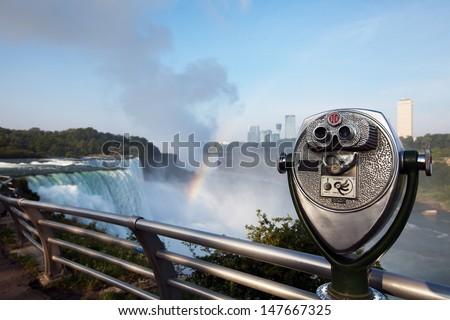 Tourist binoculars on the observation deck Niagara Falls - stock photo