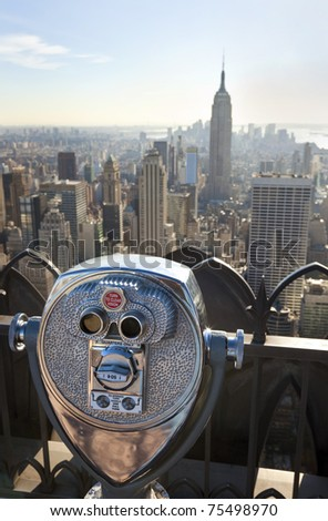 Tourist binoculars overlooking the Manhattan skyline in New York City, USA, United States of America - stock photo