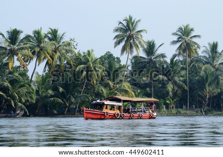 Tourist boat at Kerala backwaters,Alleppey,India.It's a chain of lagoons and lakes near Arabian Sea  (Malabar Coast) of Kerala state in southern India