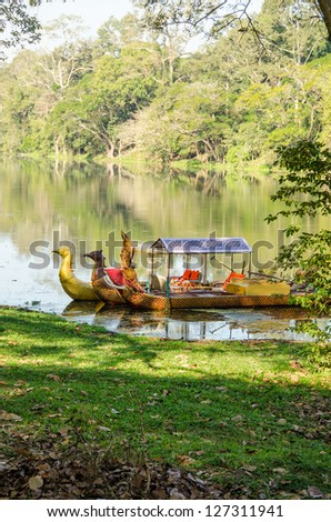 Tourist boat in the moat around Angkor Thom, Angkor, Cambodia