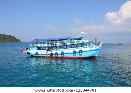Tourist boat modified from fishing on wide sea.