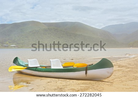 Tourist boat on misty lake. Shot in the Tsitsikamma National Park, Garden Route area, Western Cape, South Africa.  - stock photo