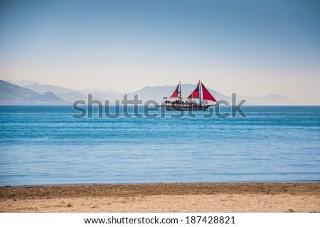 Tourist boat on the sea coast. Alanya; Turkey - stock photo