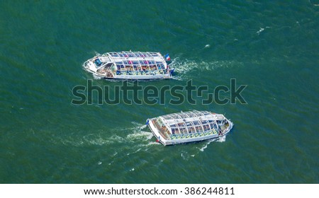 Tourist boat swimming Seine - aerial view from Eiffel Tower, Paris, France - stock photo