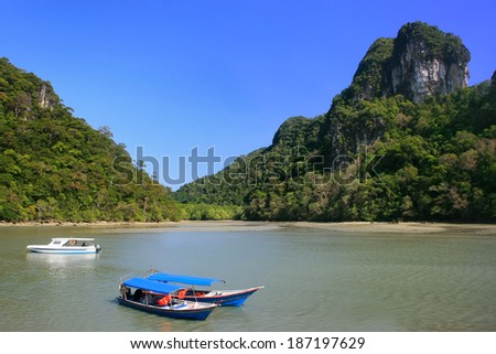 Tourist boats at Island of the Pregnant Maiden lake, Marble Geoforest Park, Langkawi, Malaysia - stock photo