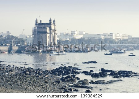 Tourist boats at the pier of monument The Gateway of India in Mumbai, India - stock photo